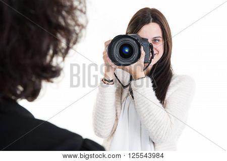 Beautiful woman photographer holding photo camera and take photo