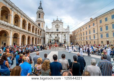 Loreto, Italy - August 19, 2016: tourists and pilgrims in front of famous Shrine of the Holy House church in Loreto Italy. The Basilica della Santa Casa contains the house in which the Virgin Mary lived.