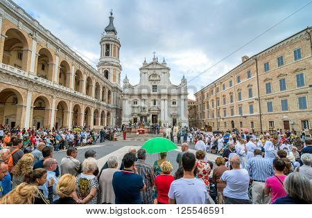 Loreto Italy - August 19 2016: tourists and pilgrims in front of famous Shrine of the Holy House church in Loreto Italy. The Basilica della Santa Casa contains the house in which the Virgin Mary lived.