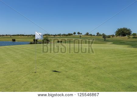 Golf course in the summer for tourists. On the green grass.