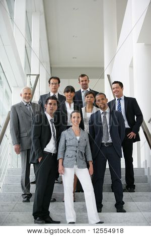 Portrait of business people standing on the steps of stairs