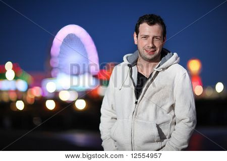 Portrait Of Casual Young Adult Man At Night