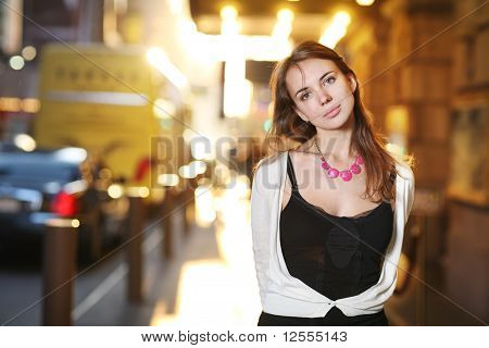 Beautiful Young Woman On Sunny Street