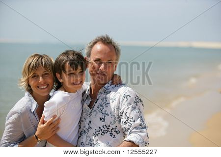 Portrait of a smiling family at the seaside