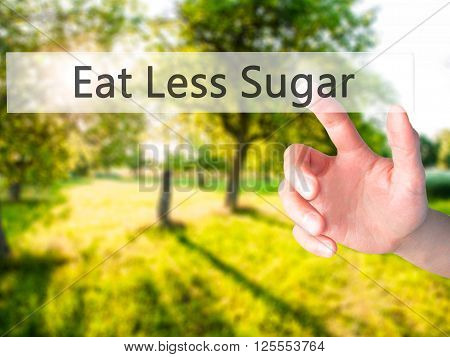Eat Less Sugar - Hand Pressing A Button On Blurred Background Concept On Visual Screen.