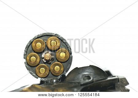 Photo of black revolver gun with cartridges isolated on white background