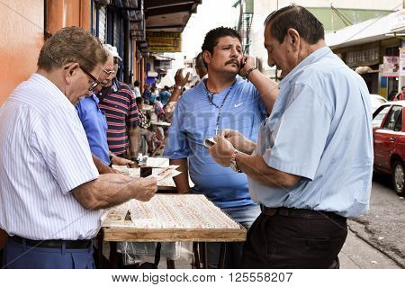 San Jose Costa Rica - August 18 2015: Man buy the lottery tickets in the streets of San Jose in Costa Rica Central America