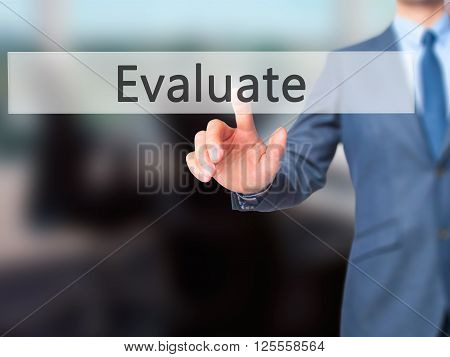 Evaluate - Businessman Hand Pressing Button On Touch Screen Interface.