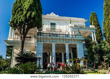 ACHILLEION PALACE, CORFU ISLAND, GREECE - August 8, 2014: People visiting the palace. It was buit by Empress of Austria, Elisabeth of Bavaria, also known as Sisi in 1890.