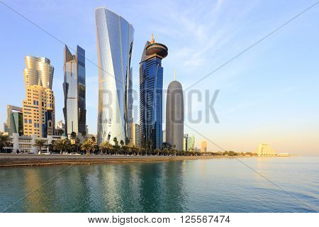 DOHA, QATAR -jANUARY 31, 2016: A view of the towers looming over Doha Bay.