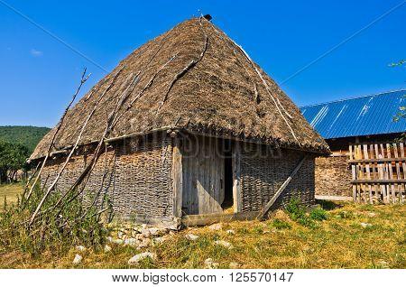 Rural wooden lodge at Pešter plateau landscape in southwest Serbia