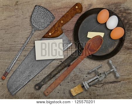 vintage set for frying eggs over wooden table space on business card for your text