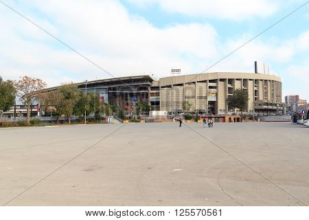 Barcelona, Spain - November 12, 2015: Football stadium Camp Nou outside. The stadium has been the home of FC Barcelona since its completion in 1957. With a seating capacity of 99354 it is the largest stadium in Spain and Europe by capacity.