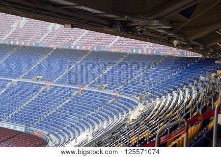 Barcelona, Spain - November 12, 2015: Football stadium Camp Nou interior stands. The stadium has been the home of FC Barcelona since its completion in 1957. With a seating capacity of 99354 it is the largest stadium in Spain and Europe by capacity.