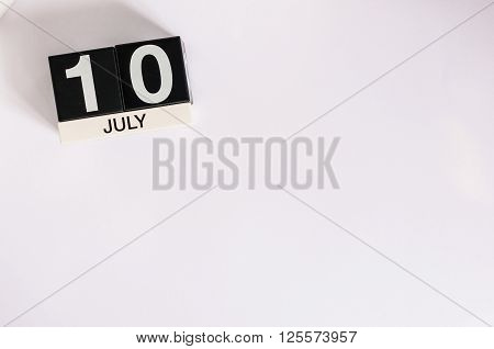 July 10th. Image of july 10 wooden color calendar on white background. Summer day. Empty space for text.