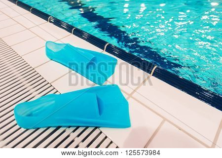 Swimming Pool Fun. Swimming Fins and the Pool. Recreation Concept Photo.