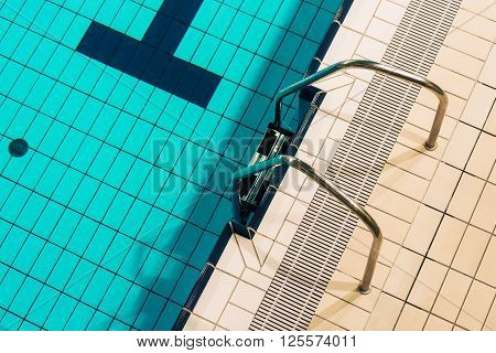 Swimming Pool Metallic Ladder Closeup Photo. Indoor Swimming Pool.