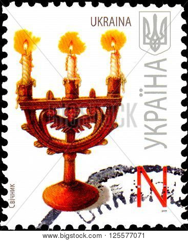 UKRAINE - CIRCA 2011: A stamp printed in Ukraine shows candlestick circa 2011.
