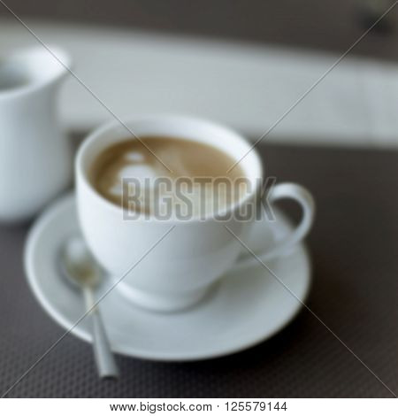 Blur Background With Cup Of Coffee Bokeh Image.
