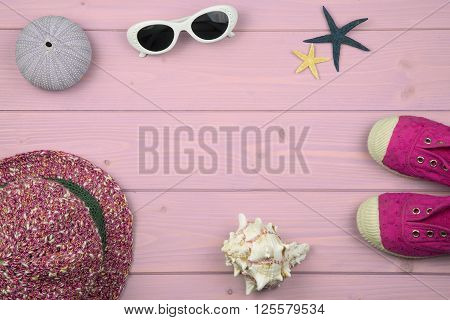 overhead of summer accessories for baby girl