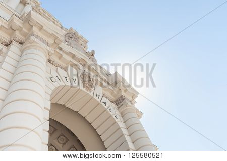 Arched entrance from low angle Pasadena City Hall in Mediterranean Revival and Spanish Colonial Revival Styles