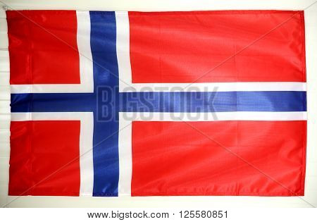 Norwegian flag hanging on the wall as a background