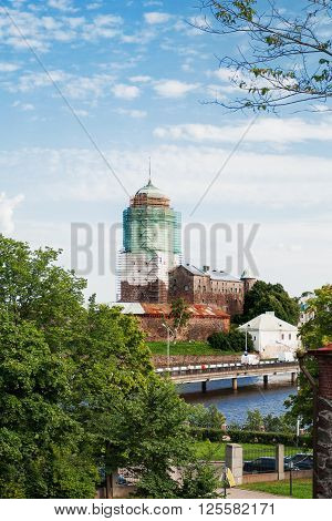 Vyborg castle. Medieval Swedish castle with St. Olav tower during reconstruction. Summer day in in Vyborg Russia.