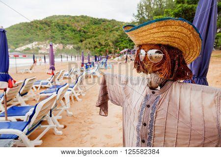 Funny scarecrow on beach. Stylish bogeyman on Phuket island Thailand.
