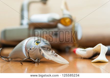 a set of fishing lures on a wooden background