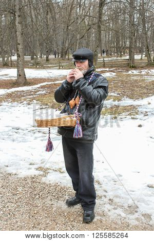 Vitoslavlitsy, Russia - March 12, Buffoon playing the penny whistle, March 12, 2016. Holiday Carnival in general Vitoslavlitsy near Novgorod.