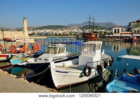 Venetian harbour and lighthouse in city of Rethymno Crete Greece