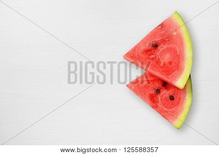 Watermelon slices on white table top view