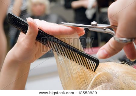 Blonde woman at hair saloon