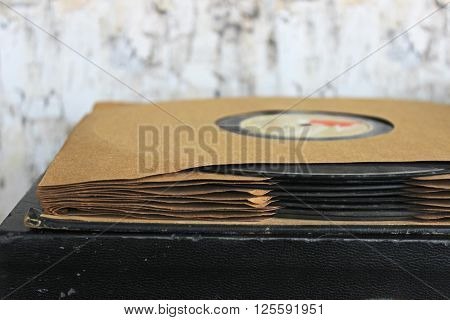 Stack of vintage gramophone records on a record player with room for copy