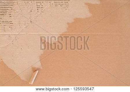 Torn corrugated cardboard background with place for text.
