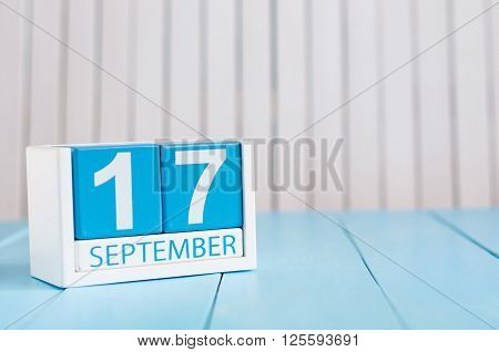 September 17th. Image of september 17 wooden color calendar on white background. Autumn day. Empty space for text.