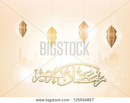 Glossy Arabic Islamic Calligraphy of text Ramadan Kareem with traditional hanging lamps on Mosque silhouetted shiny background.
