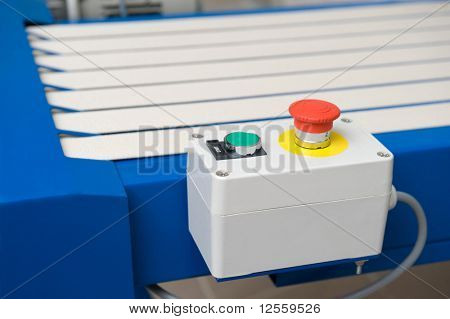 Pushbutton of the conveyor in a warehouse