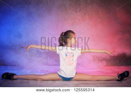 Gymnastic Girl Doing Twine.