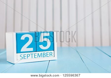 September 25th. Image of september 25 wooden color calendar on white background. Autumn day. Empty space for text. International Deaf Day.