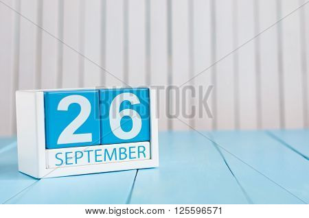 September 26th. Image of september 26 wooden color calendar on white background. Autumn day. Empty space for text.