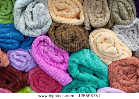 A stack of colorful rolled towels