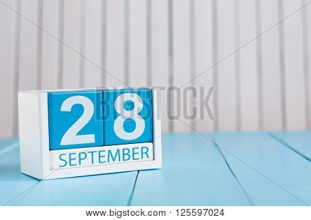 September 28th. Image of september 28 wooden color calendar on white background. Autumn day. Empty space for text.