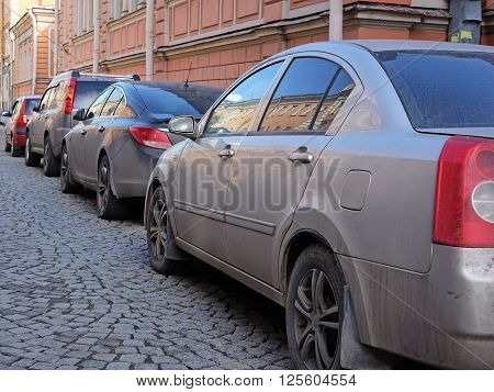 St. Petersburg, Russia - on April 3, 2016: Cars on a parking in St. Petersburg, Russia