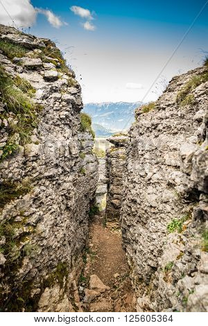 Trench dug in the rock dating back to World War I located on the Italian alps.