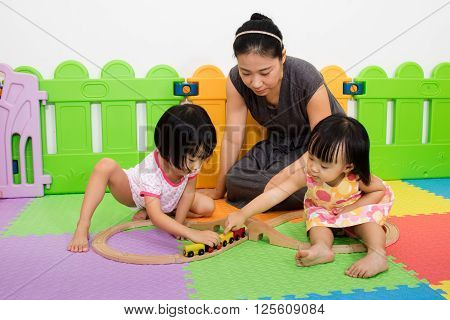 Asian Kids And Mother Playing Together