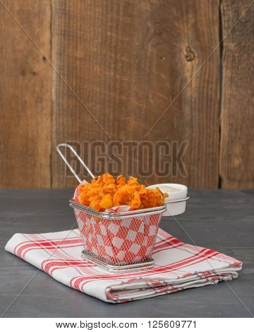 Basket of sweet potato fries with a buttermilk dill dipping sauce.