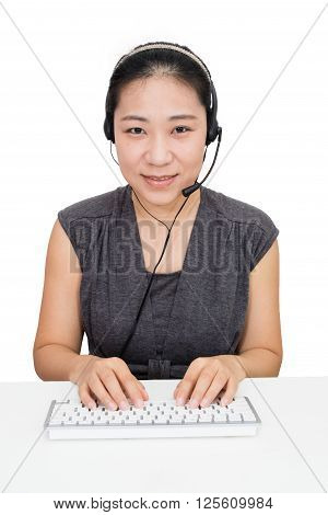 Asian Woman with Headset Using Keyboard in Isolated White Background