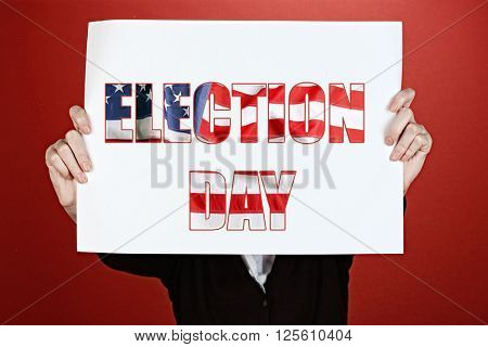 Woman holding paper with Election Day text on red background