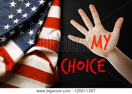 Male hand with text My Choice and USA National Flag on black background